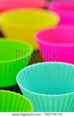 Empty colorful muffins silicone cup on table