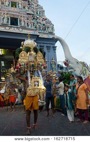 Singapore 7 February 2012: A Hindu devotee carries a kavadi during outside the Sri Perumal Temple at the annual Thaipusam festival.