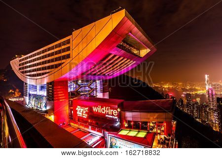 Hong Kong, China - December 7, 2016: The Peak Tower and rooftop restaurant atop Victoria Peak by night. The Peak Tower and spectacular views of Victoria Harbour and skyline of Hong Kong.