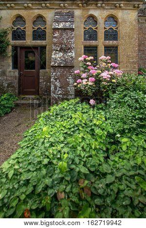 TIVERTON, UK, 13 July 2016: Details of an old English castle Knightshayes. Devon. UK