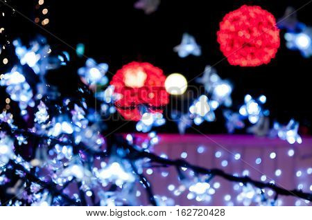 blury red light balls and white lights in forground