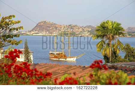 Traditional Ecuadorian sailboat sailing in the Guayas river on a sunny summer day. Guayaquil, Ecuador