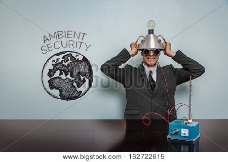 Ambient Security text with vintage businessman and machine at office