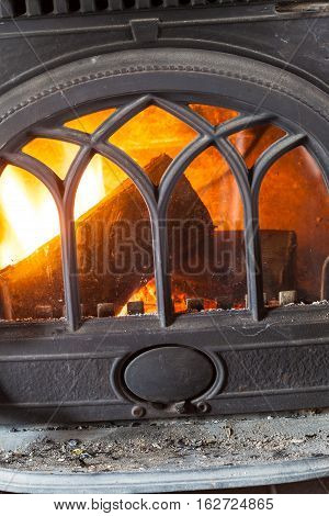 Closeup of burning fire wood in home fireplace. Heating