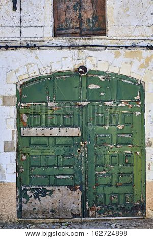 Antique Green Door In The Downtown Of Evora. Portugal.
