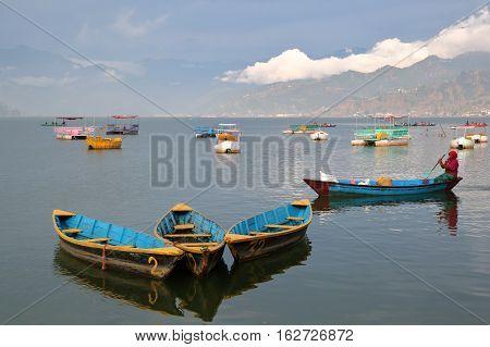 POKHARA, NEPAL - JANUARY 3, 2015: Colorful rowing boats on the Phewa Lake