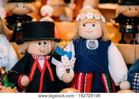 Traditional Souvenirs Ethnic Folk National Wooden Dolls Toys At European Estonian Market. Popular Souvenir From Tallinn, Estonia