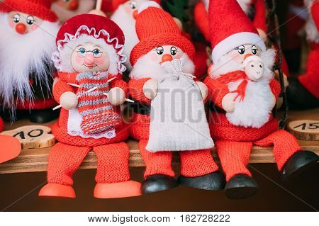 Traditional Souvenirs Santa Claus Dolls Toys At European Winter Christmas Market. New Year Wooden Souvenir From Europe.