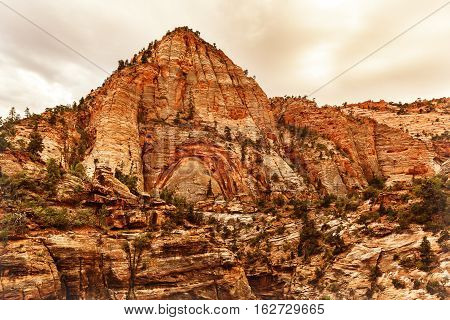Layers upon layers of red rock peaks at sunset time Zion National Park Utah