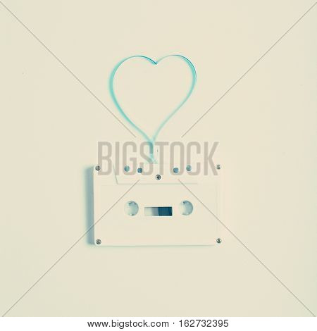 Vintage music cassette with heart shape made by the tape