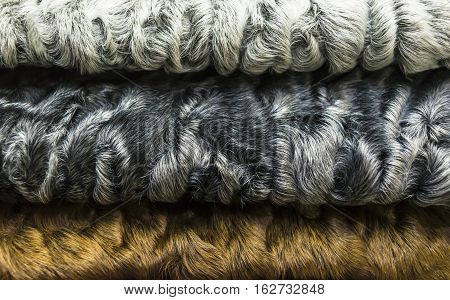 different colors of karakul lambskin texture, background