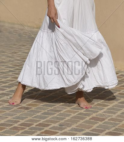 Fragment photo of flamenco dancer, only legs cropped, Legs fragment photo of spanish flamenco dancer on a street ground