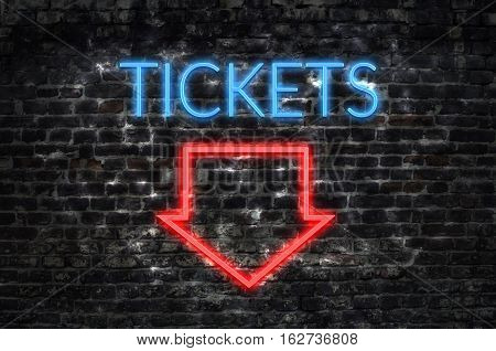 Tickets neon sign on dark brick wall background