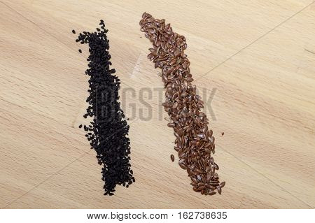 Poppy Seeds And Linseed On Wood Surface, Spices Background.