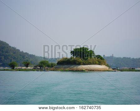 Close up view of small Lalu Island along Sun Moon Lake in Taiwan