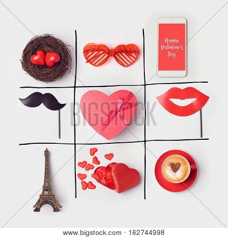 Valentine's day background with heart shape and party accessories. Tic tak toe game concept. View from above. Flat lay