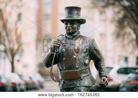 Tallinn, Estonia. Bronze Statue Of A Lucky Happy Chimney Sweep With Some Bronze Footsteps Behind Him. Close Up