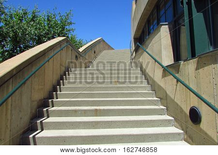 An ascending outdoor concrete staircase on a summer day in Burlington VT.