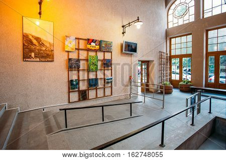 Tbilisi, Georgia - May 20, 2016: The Modern Interior Of Lower Station Of Funicular, Urban Public Transport. The Illuminated Hall With Colorful Pictures On The Wall.