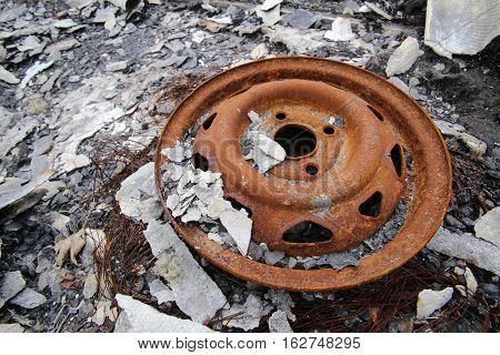Car Rim On A Heap Of Debris