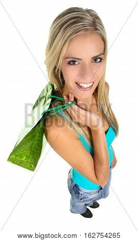 Lovely blond shopping lady holding colorful bags - isolated
