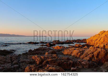 Sunrise at a rocky shore. Summer sunrise. Amazing sunrise.