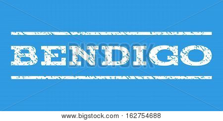 Bendigo watermark stamp. Text tag between horizontal parallel lines with grunge design style. Rubber seal stamp with unclean texture. Vector white color ink imprint on a blue background.