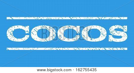 Cocos watermark stamp. Text tag between horizontal parallel lines with grunge design style. Rubber seal stamp with dirty texture. Vector white color ink imprint on a blue background.