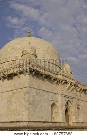MANDU, MADHYA PRADESH, INDIA - NOVEMBER 19, 2008: Ancient islamic tomb of Hoshang Shah in the hilltop fortress of Mandu in Madya Pradesh, India. White marble building. 15th Century AD