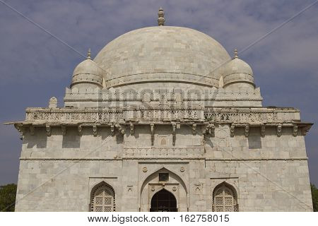MANDU, MADHYA PRADESH, INDIA - NOVEMBER 18, 2008: Ancient islamic tomb of Hoshang Shah in the hilltop fortress of Mandu in Madya Pradesh, India. White marble building. 15th Century AD