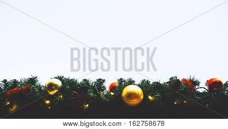 Christmas balls hanging on a Christmas tree. Christmas tree background with copy space. Christmas in Europe. Outdoor Christmas decorations.