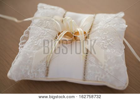 infinity sign of the rings wedding rings on a white backgroundwedding bands wedding rings on a cushion