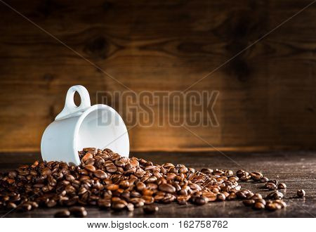 scattered on the wooden table coffee beans