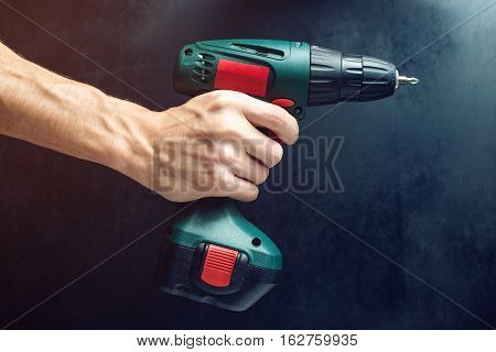Male Hand Holding A Screwdriver, For Screwing Screws