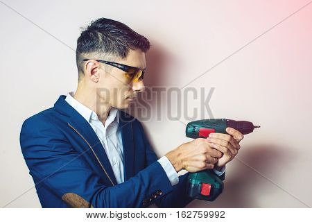 Man In Suit Holding A Screwdriver Like Weapon