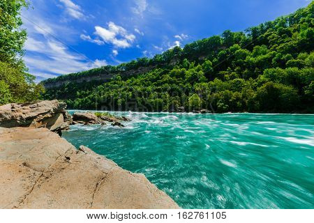 gorgeous amazing beautiful stunning view of Niagara Falls escarpment rushing river and grounds on sunny summer day poster