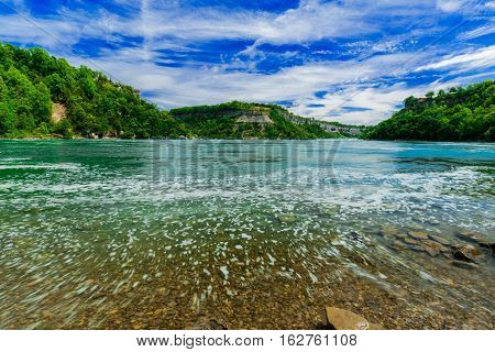 beautiful amazing natural  gorgeous landscape view of Niagara falls escarpment river and blue sky background