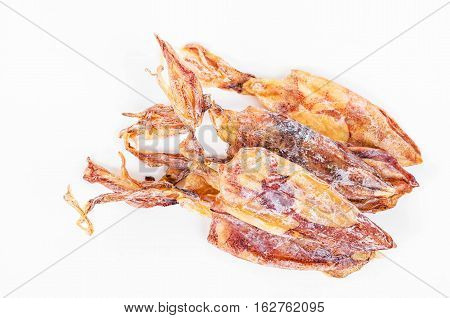 plenty of dried squids on white background.