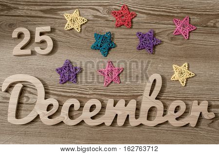 Christmas Eve Date On Calendar. December 25. Wooden Background. 25th day of calendar last month of the year.