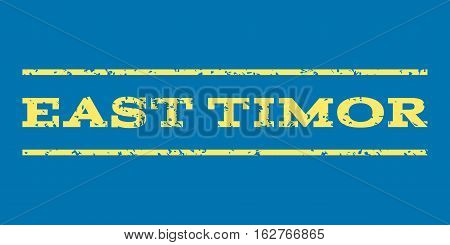 East Timor watermark stamp. Text caption between horizontal parallel lines with grunge design style. Rubber seal stamp with unclean texture. Vector yellow color ink imprint on a blue background.