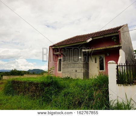 abandon house in mountain not maintained with bush and small plant grow near that in bogor indonesia photo