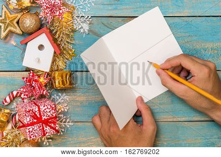 Christmas Background With Decorations With Hand Writting On Greeting Cards. Top View With Copy Space