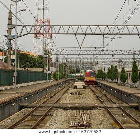 A commuter line is entering Bogor station taken in Bogor Indonesia java