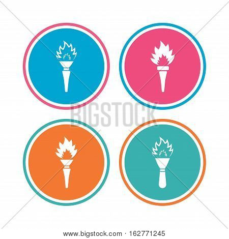 Torch flame icons. Fire flaming symbols. Hand tool which provides light or heat. Colored circle buttons. Vector