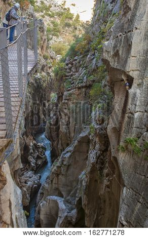 One trekker man leaning out the footbridge at Caminito del Rey path Malaga Spain