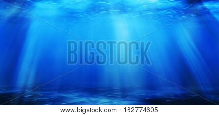 Dark Marine Seascape With Raylight, Deep Ocean Underwater For Use As Water Background.