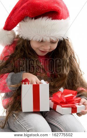 Happy small girl holding a box with a gift. Merry Christmas. Happy New Year