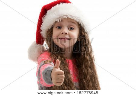Happy small girl in costume New Year doing thumbs up. Merry Christmas. Happy New Year