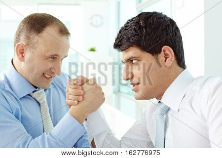 Portrait of two wrestling managers in office