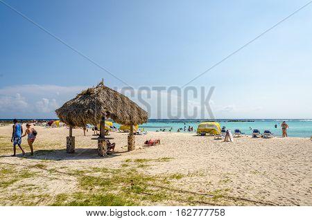 View Of Tourists Enjoying  Baby Beach On Aruba